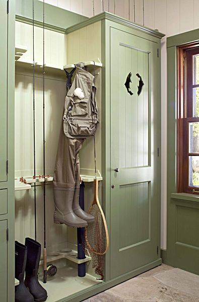 Great Mud Room idea... using a great pale green cabinet for storage..