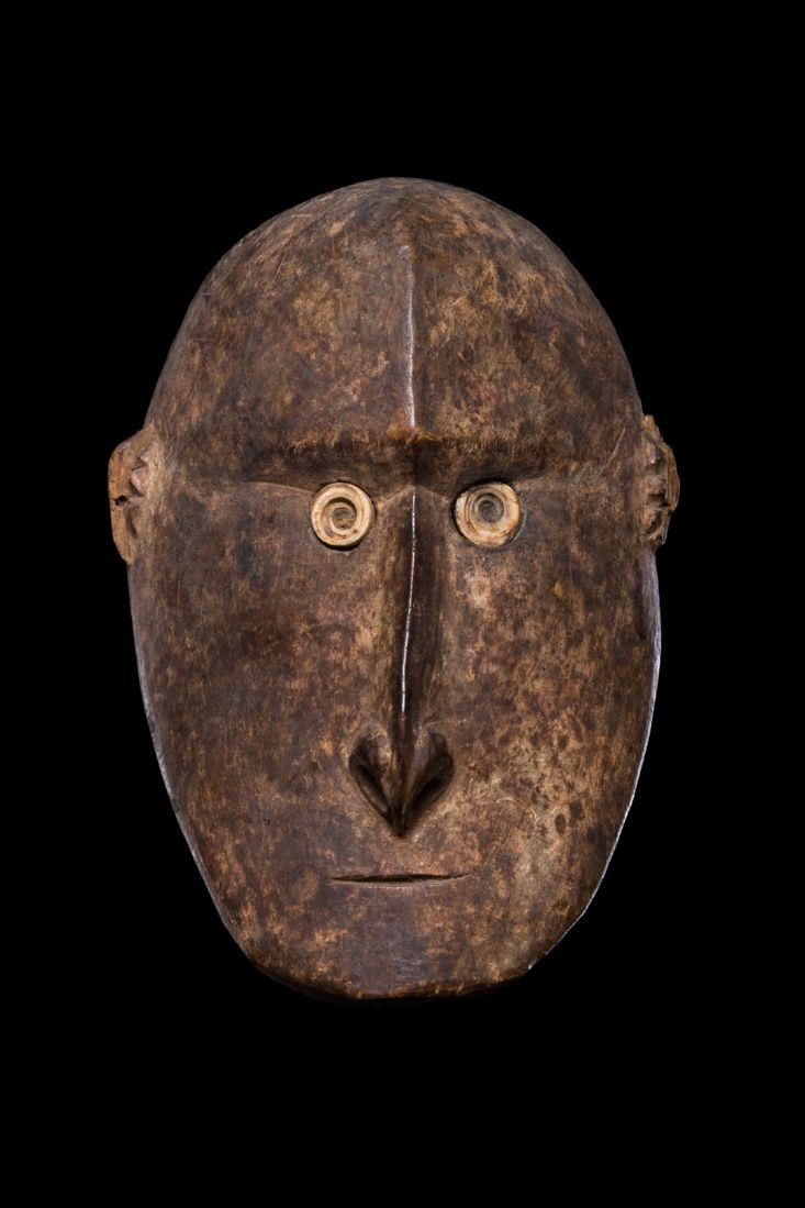 From the Sawos area, north of the Middle Sepik River in Papua New Guinea. This is a wooden head used in a ceremony, where a human head would have been used before.
