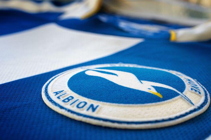 Brighton & Hove Albion football shirt & badge