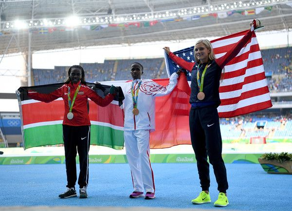 Ruth Jebet (C) of Bahrain poses with the gold medal, Hyvin Kiyeng Jepkemoi (L) of Kenya, silver medal, and Emma Coburn of the United States, bronze medal, for the Women's 3000m Steeplechase final on Day 10 of the Rio 2016 Olympic Games at the Olympic Stadium on August 15, 2016 in Rio de Janeiro, Brazil.
