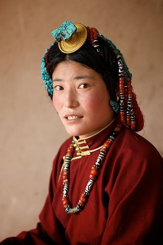 Yushu, Tibet 005  This woman is dressed in typical Kham-Tibetan jewelry. She's smiling strangely because she wants to make sure you can see her gold teeth...A definite fashion must-have in Tibet.