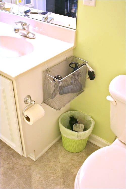 Mount a basket on your #bathroom vanity to keep your hairdryer/straightener/curler off the sink & out of the way