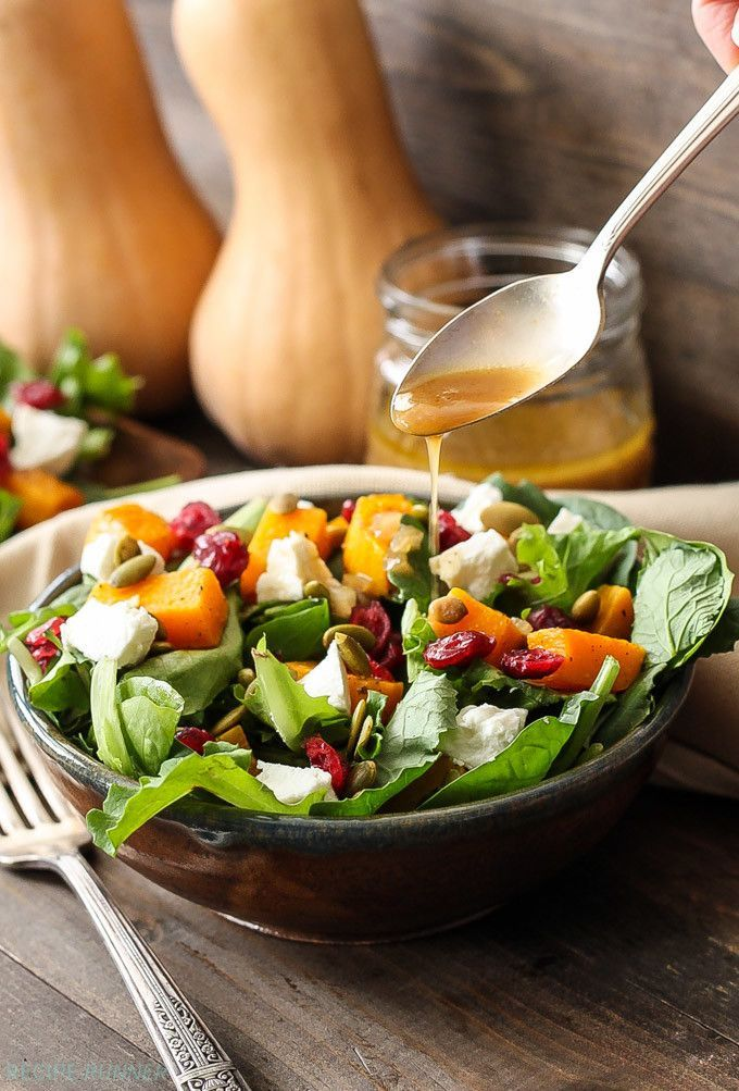 Roasted butternut squash, cranberries, goat cheese, & pepitas piled on a bed of baby kale. Drizzle this fall salad with the delicious cider vinaigrette.
