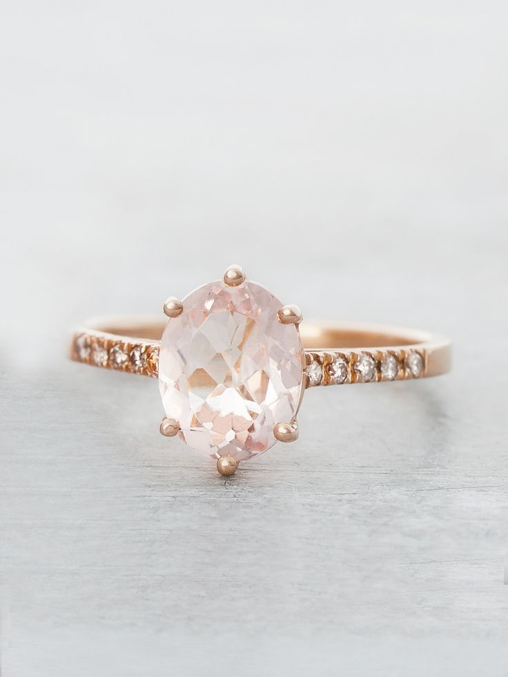 Sparkling with Love and Light, a pastel-pink Oval Morganite gem glows with the ultimate feminine beauty. Set in our timeless six-prong setting with ten Champagne Diamonds for the perfect shimmering ad