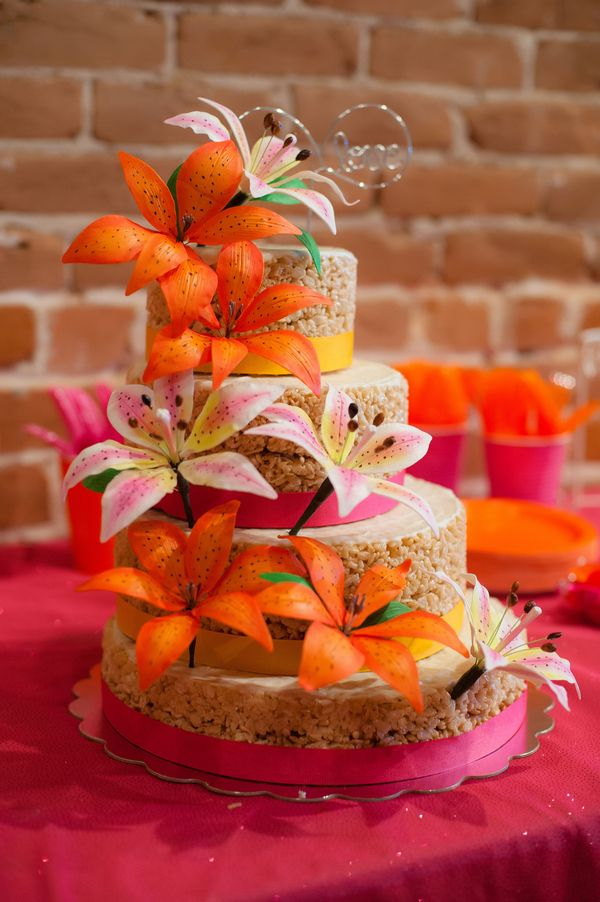 Rice Krispie Wedding Cake decorated with pink and orange flowers