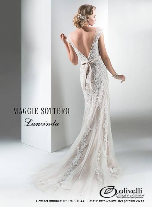 Bold floral lace appliqués cascade atop this soft tulle sheath, complete with covered button and zipper over inner elastic back closure. Available with dazzling Swarovski crystal satin ribbon belt. #MaggieSottero #OlivelliCT #WeddingGown