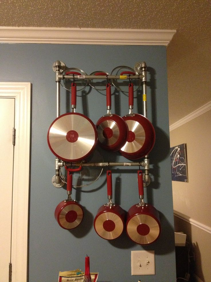 Easy diy pot pan rack made out of pipes pot racks for Kitchen s hooks for pots and pans