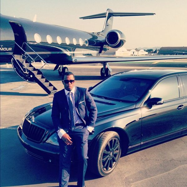 P. Diddy shows off his blacked-out Maybach parked next to his private jet