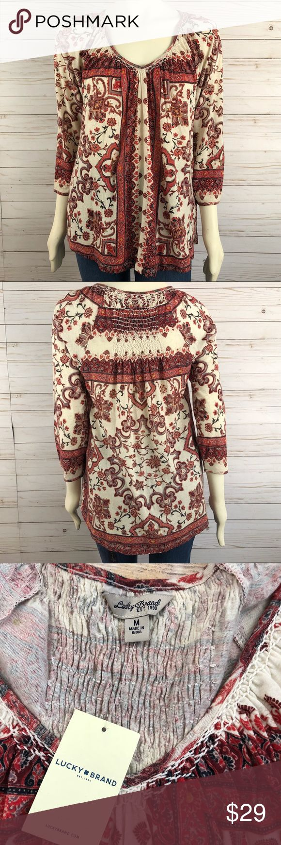 Lucky brand bohemian print top NWT Lucky brand Bohemian style/boho print/floral   3/4 sleeves, elastic at sleeve hem Loose flowy fit  Smocked in between shoulder blades Combo multicolor, burnt orange, red etc Lucky Brand Tops
