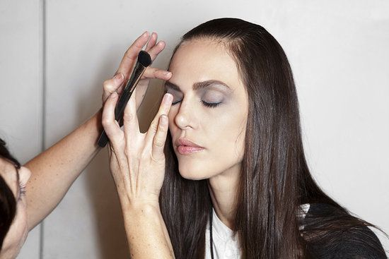 Floriane David of Make Up For Ever Academy recommends applying mascara onto a fan brush, and then paint onto the lashes for better coverage. Get more pro makeup artist tips when you click!