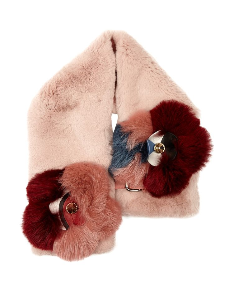 Fendi's rose-pink rabbit-fur scarf is an extension of the label's fun, feminine Flowerland series. It features red, blue, white and black leather flowers, each framed by tonal fox-fur petals, and set with a sparkling crystal centre. Fasten it with the smooth-leather buckle.