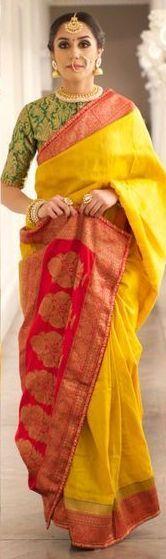 Yellow and Red Banarasi Saree by Ayush Kejriwal. Love the saree blouse design and the jewellery. #jhumkas #jhumkis #nosering #maangtikka Indian fashion.