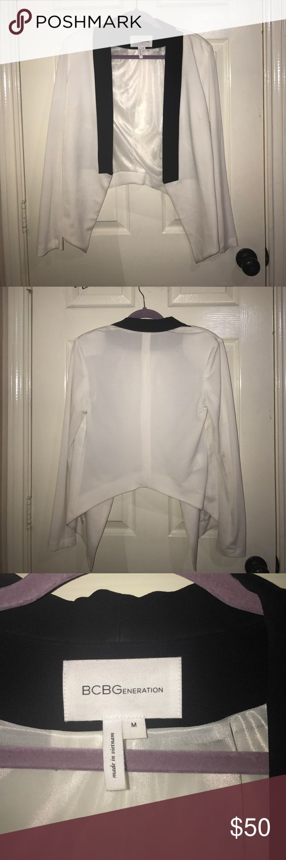BCBGeneration Blazer White and black BCBG blazer. Has a soft white lining. Worn twice. Small snag on the sleeve but there is not any thread coming out! Negotiable pricing! Medium. BCBGeneration Jackets & Coats Blazers