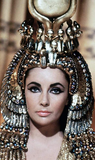 Cleopatra....oh i remember watching this movie over and over in Latin class. My Latin teacher (a former nun) was obsessed with the scene where Elizabeth Taylor slaps Mark Anthony and then he bitch slaps her back. She would rewind it and play it over and over. LOL