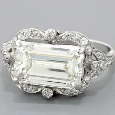 Emerald-cut Art Deco-style engagement ring. I love the direction of the diamond!