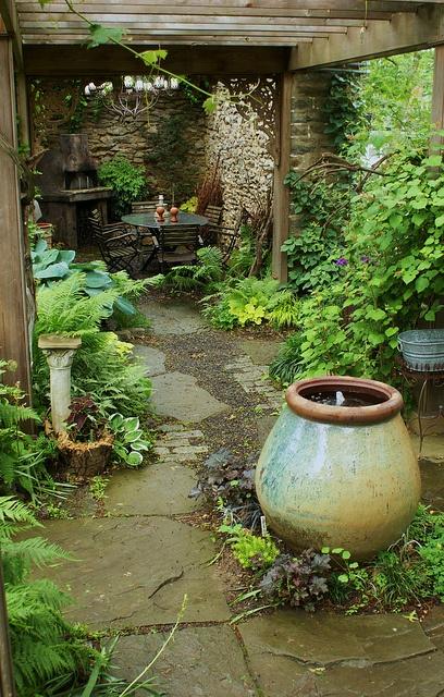 Water Feature Urn In Wooden Arbor Landscape Garden