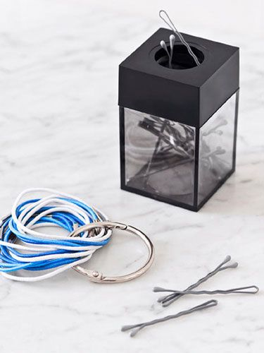 Use a magnetic paperclip holder for your bobby pins and a binder ring for your hair ties.