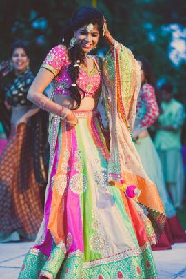 Mehendi Outfits - Shimla Wedding of Roshan & Punya | WedMeGood | Bride in a Multi-colored Pink, Green and Blue Silk Lehenga with a Pink Blouse #wedmegood #realwedding #indianbride #indianwedding #lehenga #bridal