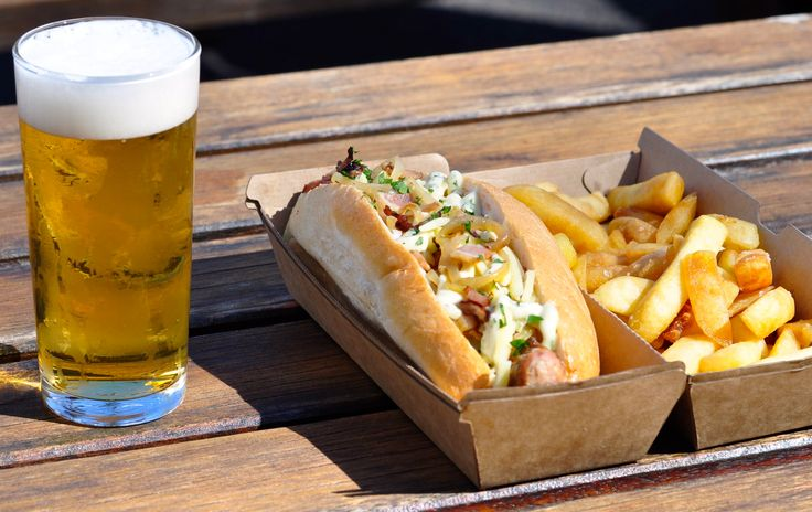 The #Village Dog - part of our #GardenFood menu from the #kiosk at Village Melbourne. #yum #food #hotdog #chips #beer