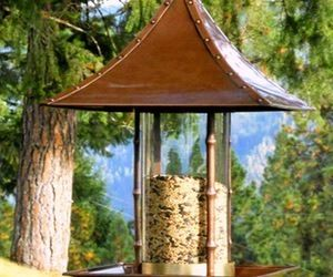 This designer bird feeder brings a touch of Asian design and class to your backyard. It's made of steel with a brass trim and copper finish and looks stunning. Set this up and you'll be able to go bird watching anytime because all of the birds will be flying for miles around to grab food from here.