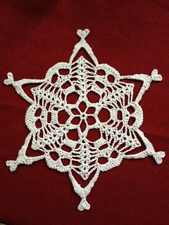 I created this pattern after being challenged by a friend to create a snowflake with skulls on it. Being a knitter at heart, I had only just begun to crochet when I broke my hand and found myself in a cast. It may seem like a complicated pattern but take heart! I created this and made a whole army of them after crocheting for 1 month.