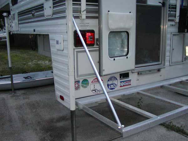 """Page 1 of 3 - My porch is done. - posted in Beach Buggy Forum: Just got done with the porch for my 915 Lance camper. This one is a little different then the one on my friend Phils truck. There is no welding. Its a complete bolt up job. There is no hinge on this one either because I dont have a rear bumper like he did. I couldent find any open end turnbuckles like the ones he had for the braces, so I made up solid connections with 3/4"""" thinwall electrical pipe. So here we go. The frame..."""