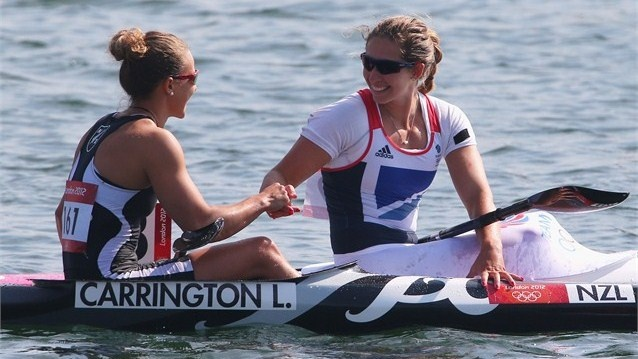 Lisa Carrington of New Zealand is congratulated by Jess Walker of Great Britain after winning gold in the women's Kayak Single (K1) 200m Sprint final.