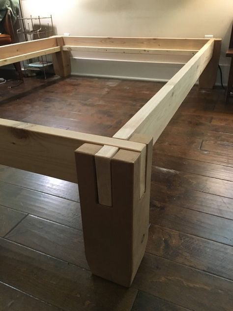 Notched cedar timbers easily stack together with no tools to make a solid bed…