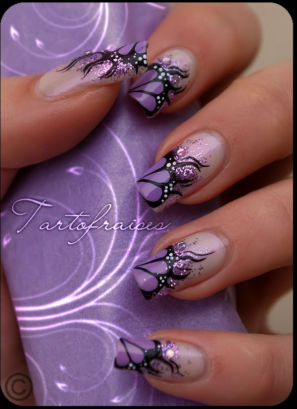 Purple Nail Art - pretty butterfly version I can't believe some of the nails on Pinterest. These people are artists!