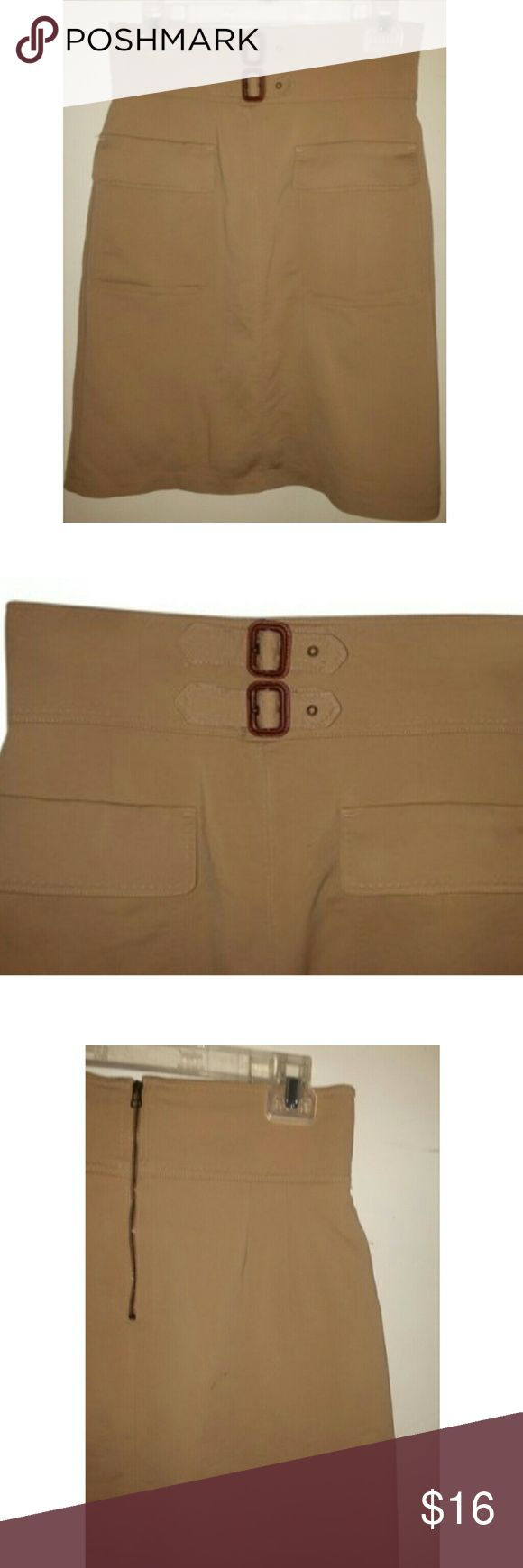 Zara tan pencil skirt with belt and pockets Zara tan pencil skirt - size medium. 23 inch length, fully lined, zips up back, functional buckle on belt adjusts waist, 2 functional flap pockets on front, exposed zipper. 48% cotton, 45% polyamide, 7% elastane. lining is 100% viscose, made in Morocco. NOTE: this skirt has never been worn: however, the lining is ripped because I purchased the skirt w/o trying on and when I DID try it on I tore it - smooth! Zara Skirts Pencil