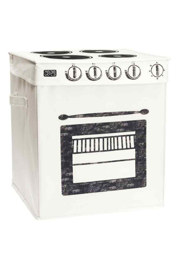 Caisse de rangement: Caisse de rangement repliable en plastique tissé avec motif imprimé. Modèle avec poignée sur les côtés. Dimensions 30x30x40 cm.