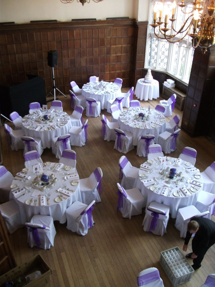Purple themed wedding with goldfish bowls filled with purple hydrangea