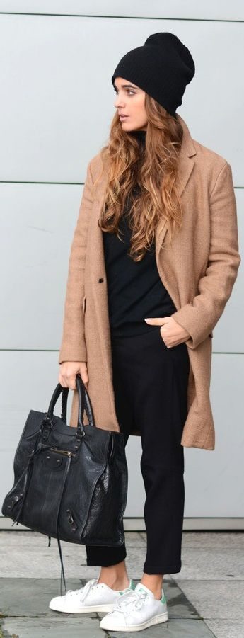 Black and camel outfit: Stella Wants To Die is wearing a camel coat and black trousers from Zara, black jumper from Mango, sneakers from Adidas Stan Smith and the bag is from Balenciaga