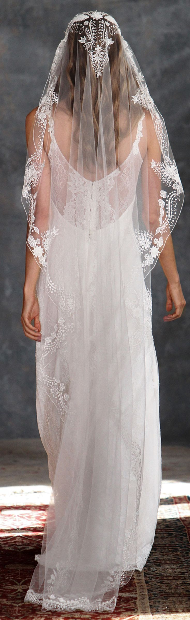 Cotton threadwork and embroidery form an organic motif of vines and leaves along the edge of tulle. This veil adds a perfect laid-back vibe with a nod to bohemian style. The embellishment remains ivory || Claire Pettibone Veil