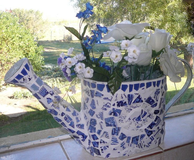 Broken china heirlooms can be turned into a cute mosaic watering can to use as a vase.