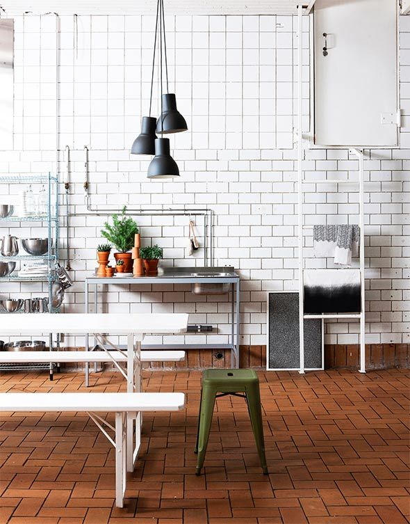 Industrial style kitchen: Udden console, Omar grate shelf, Hektar lamps, Blanda mixing bowls, white Smarta serving dishes, Korken glass bottles, Kryddig pepper grinder, Idealisk grater and colander \ Ikea. Framed gift wrap, Papershop \ Ribba frame, Ikea \ Torikoju cotton towels with herringbone pattern, Annaleena Hämäläinen \ Usva cotton towel, Anno Collection \ Beer table and benches, Hong Kong \ Stool, Tolix.