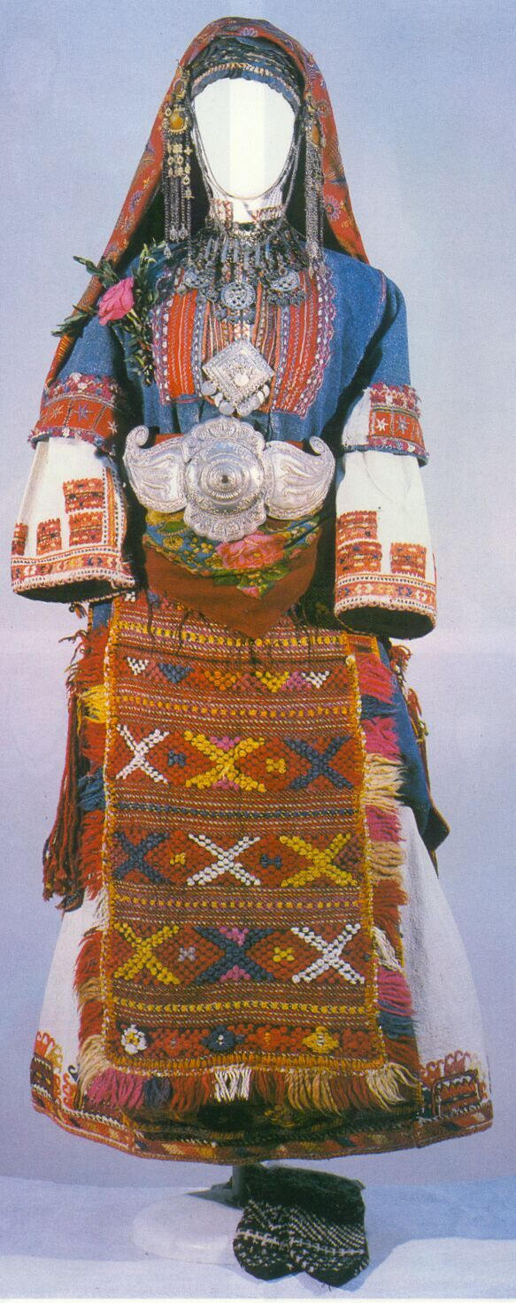 indicates that its wearer is a Bulgarian Shaman Women were very common before Christianity corrupted her traditions, this folk costume is from the village of Pirin, district of Sandanski, who is participating in a particular local rituals, in second half of the 19th century.