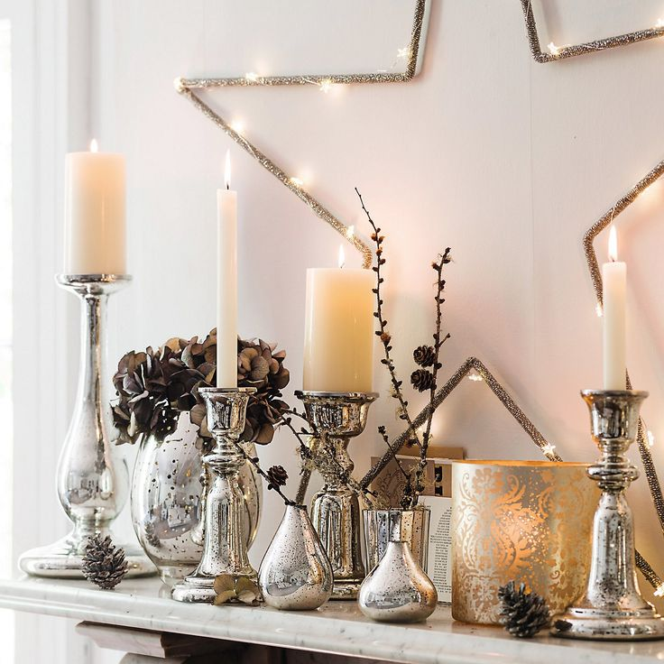 I just love these candle holders. So pretty anytime of year. The White company - Bell Dinner candle holder