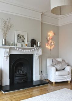 Gorgeous Modern Country living room - Farrow and Ball Pavilion Gray? Absolutely love the white mantle and that cozy chair
