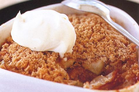 Tuck into this traditional American baked pudding, made with sweetened and spiced apples with buttered bread crumbs on top.