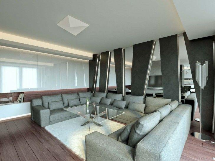 Wystrój wnętrz salonu z dynamiczną ścianą z luster i czarnej struktury. Mocne akcenty z betonu, czarnego łupka i drewna w połączeniu z dodatkami glamour tworzą niepowtarzalny klimat wnętrza.