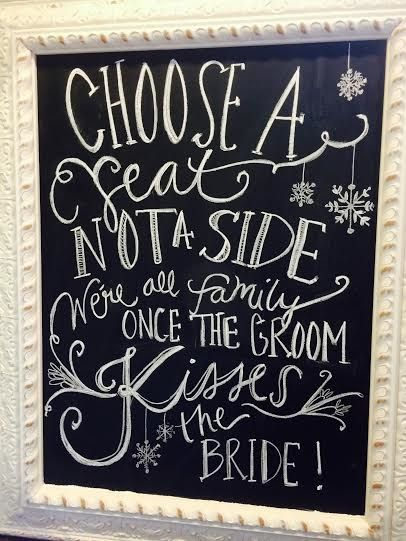 choose a seat not a side, we're all family once the groom kisses the bride. alternative seating sign for wedding on chalkboard by Chippy White Table