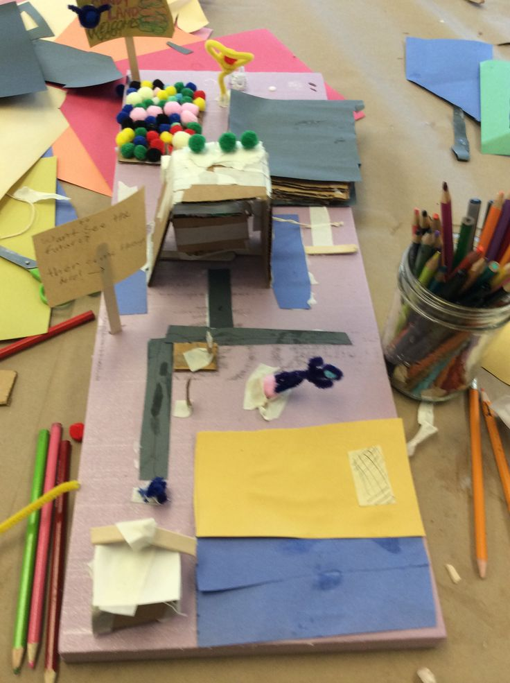 This is a work-in-progress image of our Sr. camper's collaborative dioramas. In groups of five, the campers used Styrofoam platforms to build futuristic sites relating to nature and the environment!