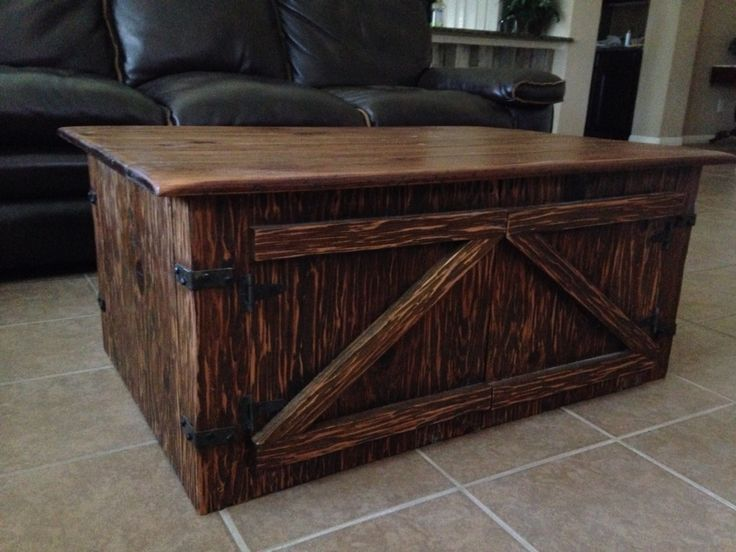 """Coffee Table/Footstool.  This was made from the panelling from Heather's grandmother's house in Tennessee Colony.  I wanted to try the Mexican hand carved look.  Instead of a hammer and chisel I put a large cove bit in my router, took off the router base and used it to """"carve"""" the wood.  I'm really glad OSHA didn't see that technique!"""