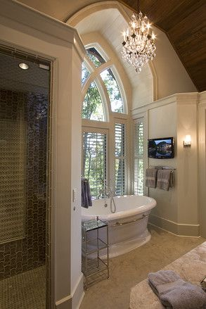NICE - focal point = tub, tall arched windows, chandelier, love the large shower and tall wood ceilings.