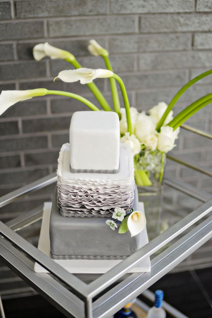Modern square-shaped wedding cake, ruffly icing, light grey and white // Andie Freeman Photography