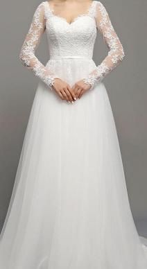 BB1282. So pretty! With lace sleeves, soft tulle skirt and open V back. Available in size 14 in store now. Come and visit us in Albany village on the North Shore. See more on http://bridalandball.co.nz/wedding-gowns/