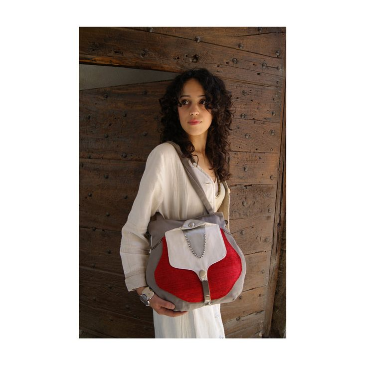 Summer 2015! Woman bag made with grey, red white furniture fabric and grey satin.  On the front side there is a big pocket, closed with a metal buckle. This bag is decorated with metal buttons, little metal chains, little metal beads. The closure is secure, with a metal zip.  Double strap, Inner lining in white cotton, with a zippered pocket. Each bag is a unique piece. Handcrafted to be extremely strong and durable, yet it is lightweight. Ideal for every occasions!  Size: Height without…