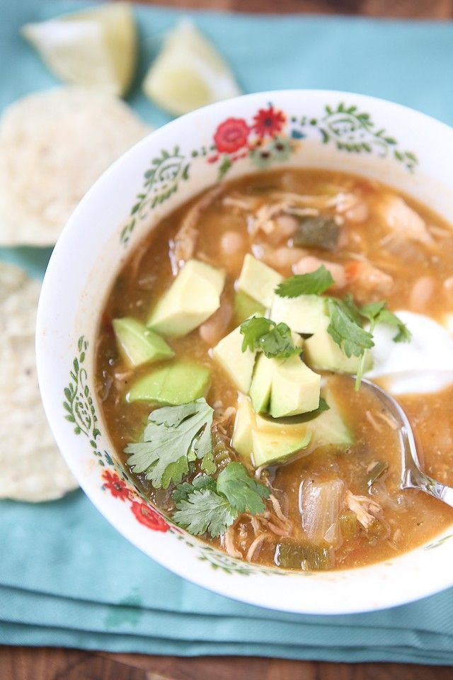 All the goodness of chicken tortilla soup (but with white chili beans!) made in your slow cooker! Pile on the toppings and make it your own - perfect for family dinner or entertaining on cool fall or winter nights.