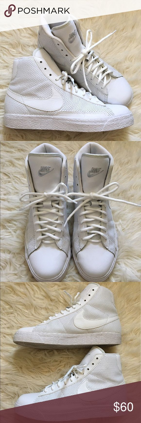 """Perforated White Leather Nike Hi Top Sneakers Perforated White Leather Nike """"Blazer Mid"""" Hi Top Sneakers. Good overall condition! See pictures for reference. Only flaw is some yellowing of letters on the back, slight discoloration on lining of tongue, & faint creases here and there. Size 6.5 youth, but I wear a women's 8 & these fit perfectly. The shoelaces are replacements and do not lace all the way up, I like them showing the tongue logo however. You can buy longer ones or leave as is…"""
